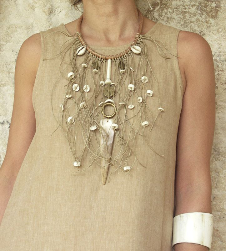 BIB Necklace: leather, white horn, linen string, fish vertebra, african beads   AMALTHEE CREATIONS
