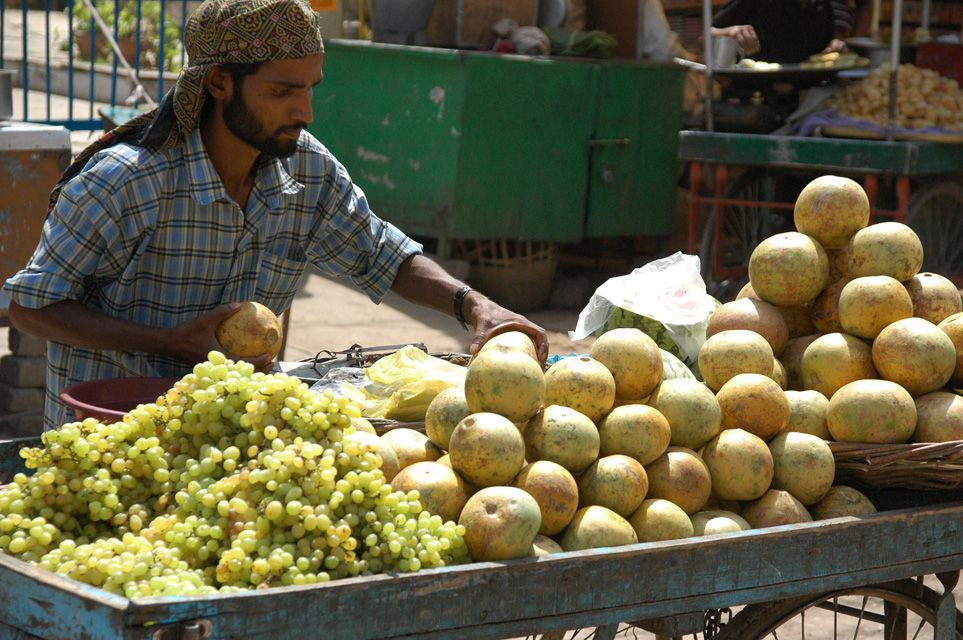 VNS Varanasi or Benares - fruit vendor preparing his stand 3008x2000