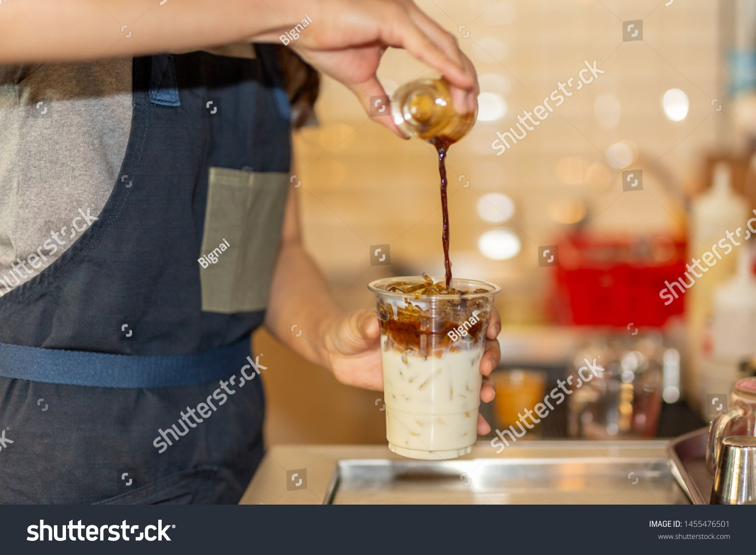 Barista pouring coffee to takeaway cup to making iced coffee latte in the cafe. #Sponsored , #ad, #coffee#takeaway#Barista#pouring