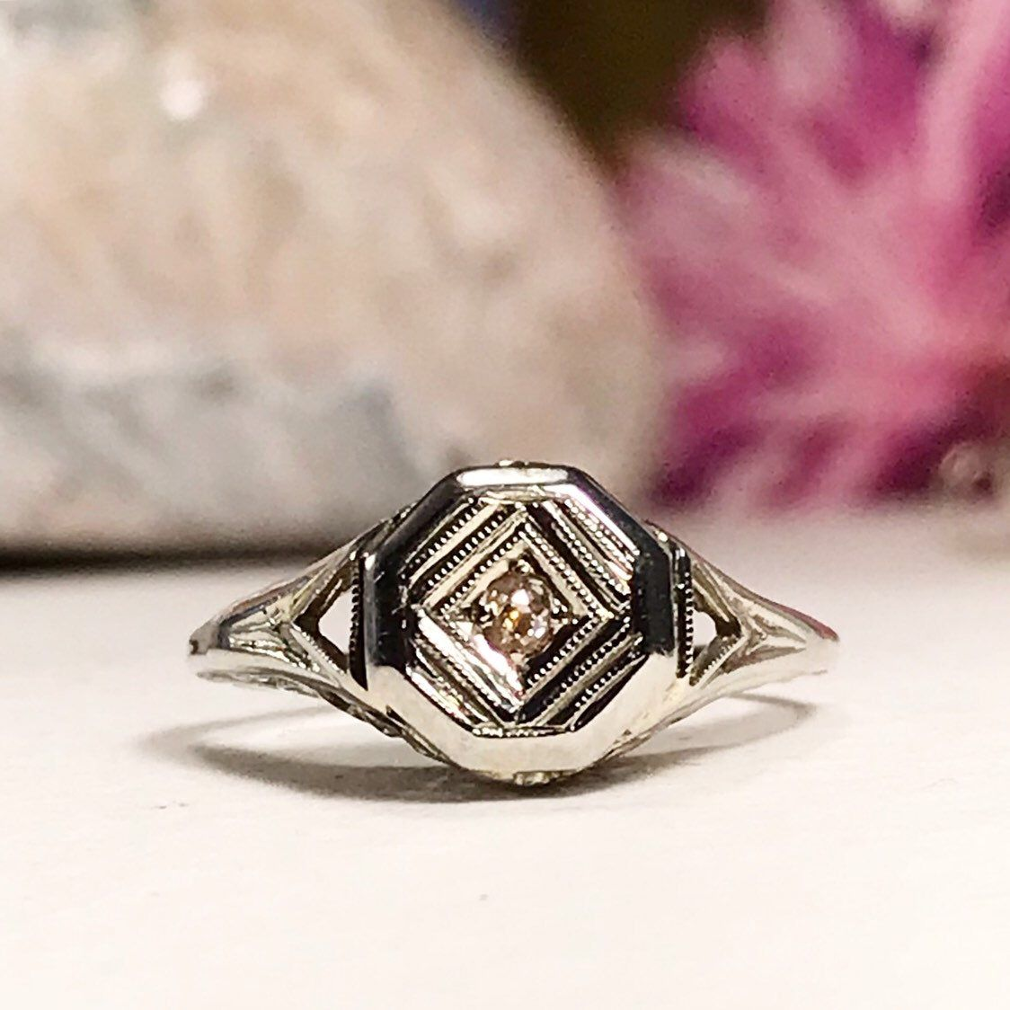 Art deco 18k white gold filigree ring with champagne