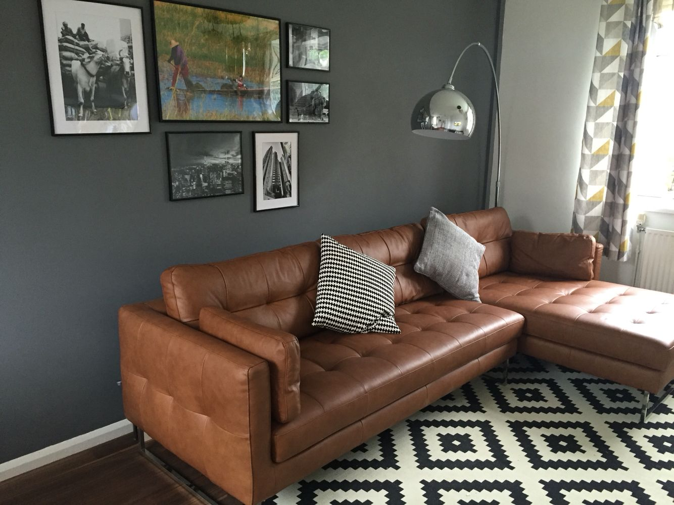 tan couch grey walls