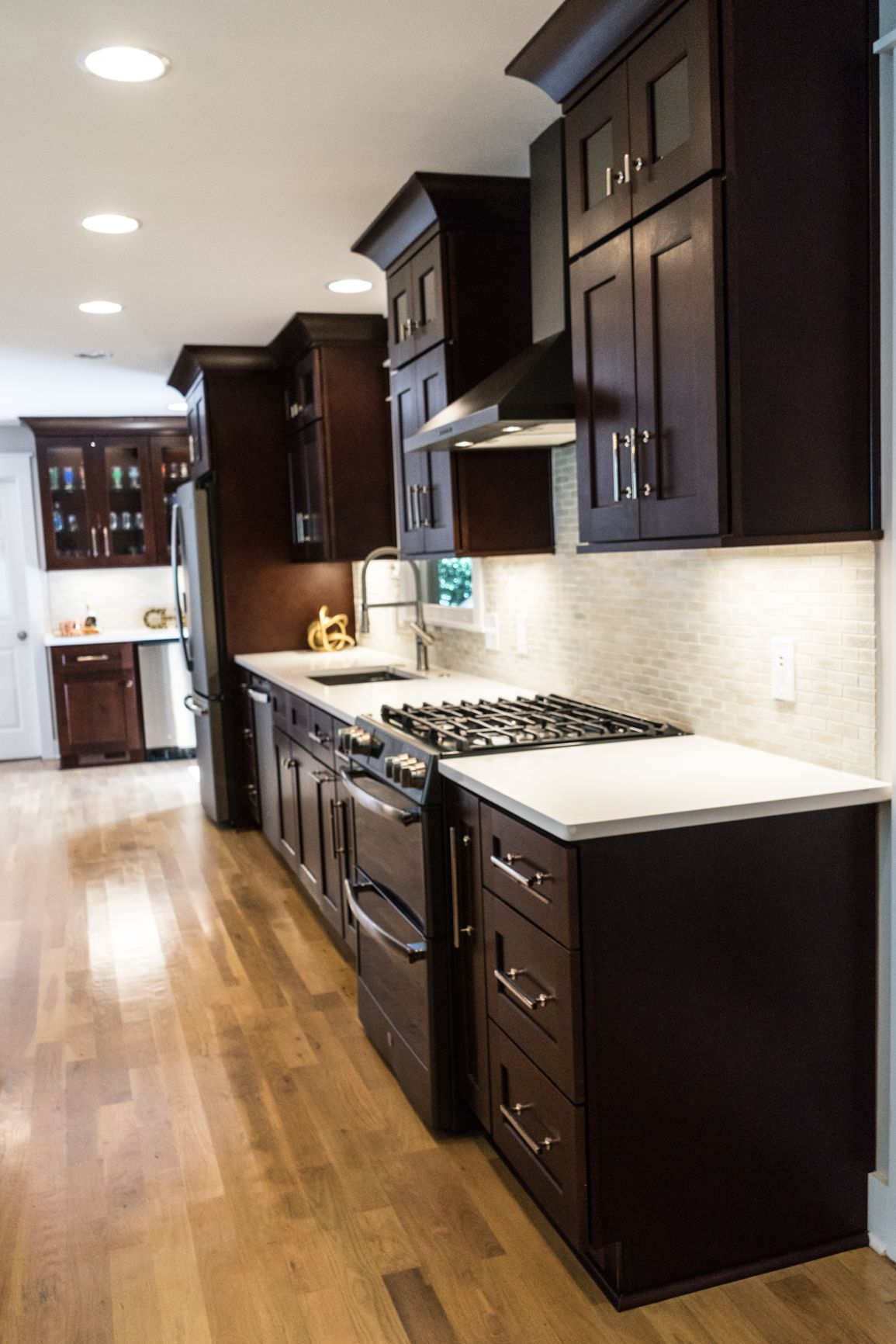 Brown Kitchen with With White Quartz Countertops