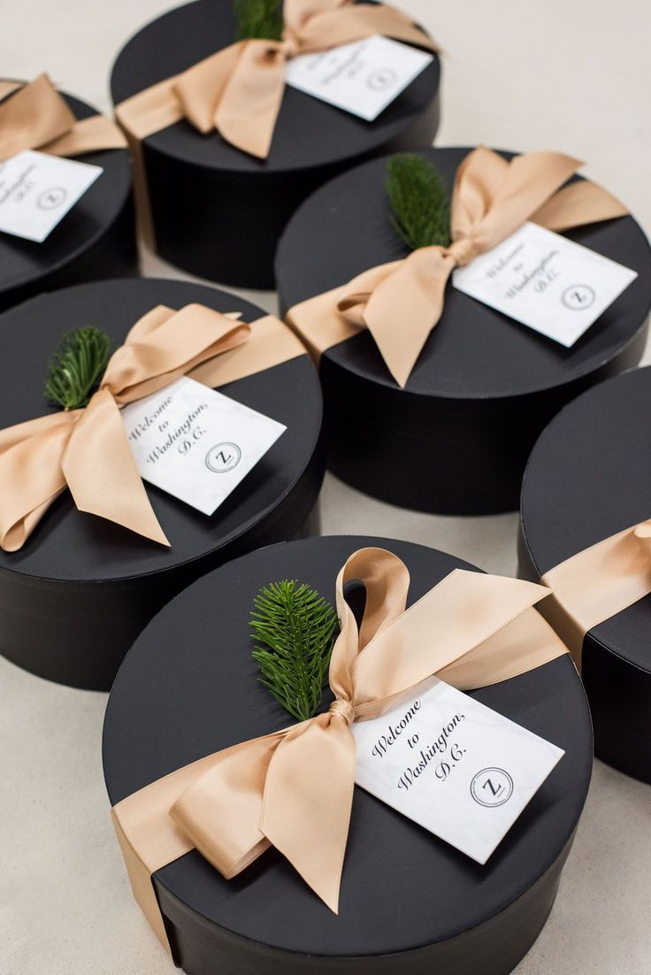 CORPORATE GIFTS// Luxurious black hatboxes welcome business professionals to a corporate event in Washington DC, curated by Marigold & Grey.  Image: Lissa Ryan  #corporategifts #professionalgifts