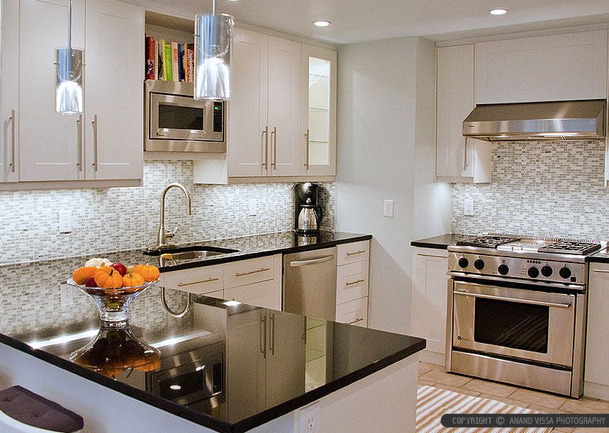 Kitchen Backsplash For Black Granite Countertops black granite and dark cabinets lighten up kitchen with white
