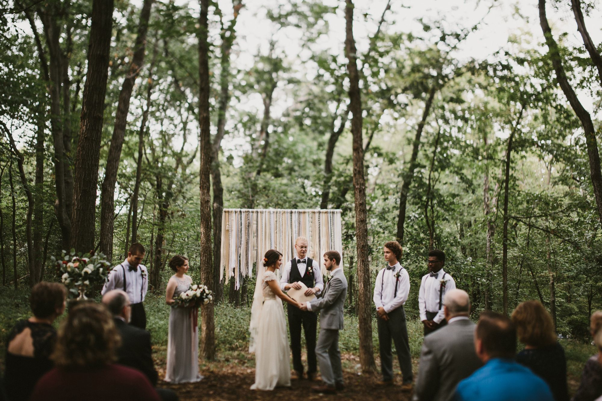 diy backyard wedding in the woods ceremony woven wall hanging