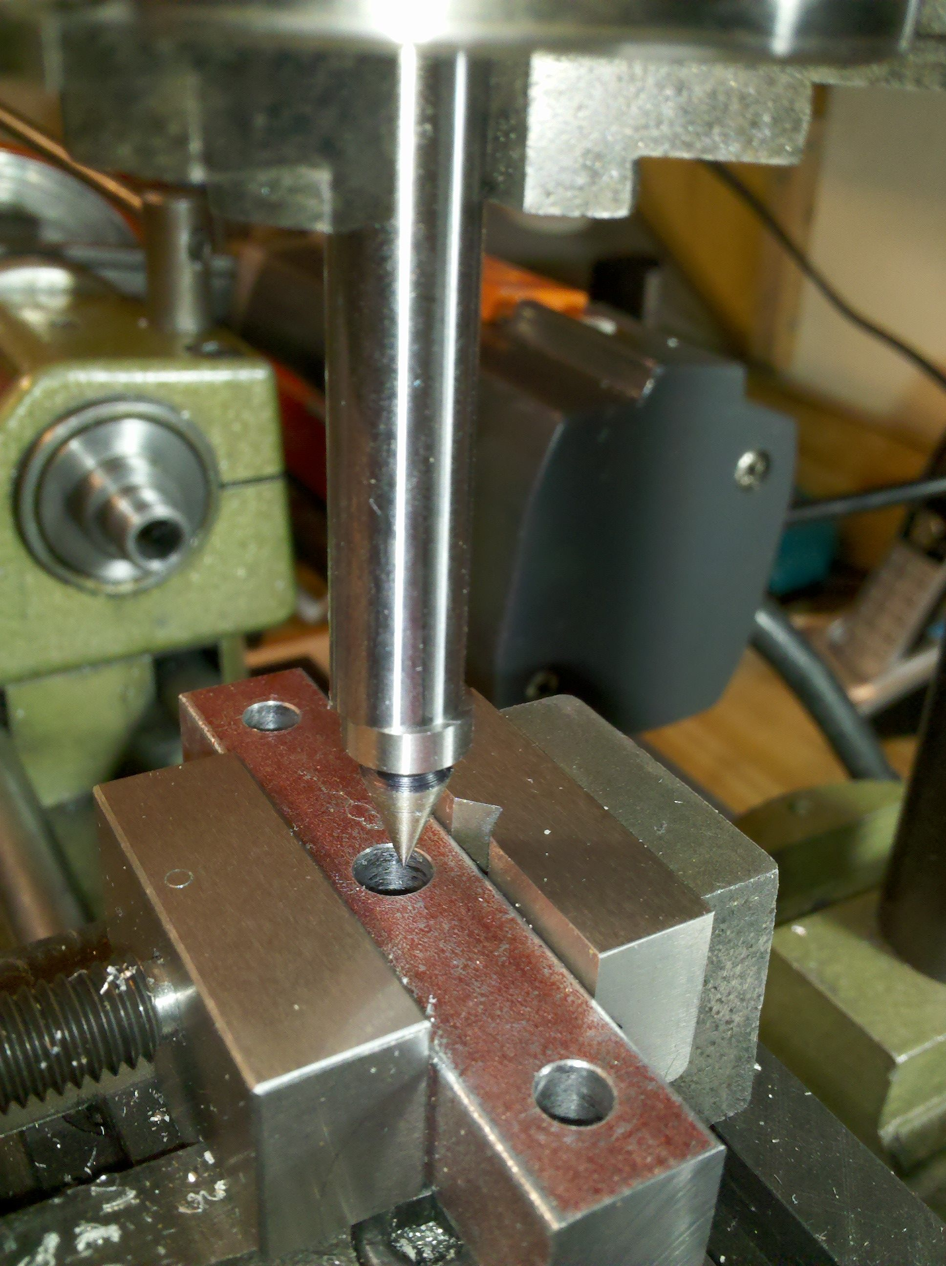 Using a Starrett center finder to align holes before reaming to size
