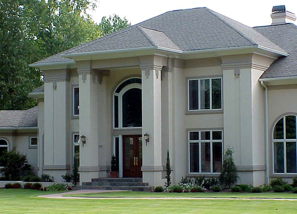 dramatic exterior with flattened columns and white stucco