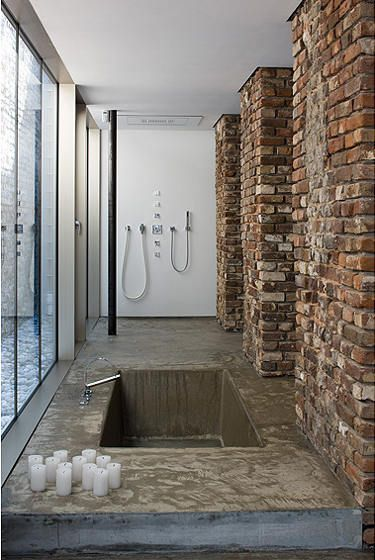 I love sunken concrete/natural stone tubs. Ultimate lux right here.