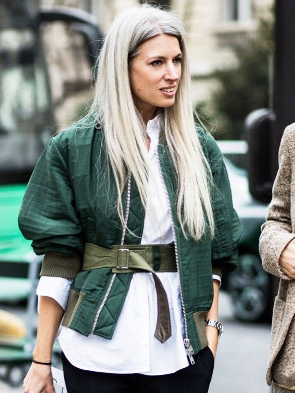 A white button-down is paired with a bomber jacket, belt, and black pants