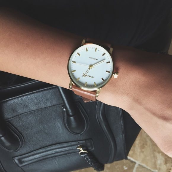 Flat Face Watch Flat Face watch with gold hardware. Adjustable tan strap (fits all sizes). More photos coming soon! First come first serve while supplies last. Find me on instagram: @theanalyssa and @shoprevoltsociety Revolt Society Accessories Watches