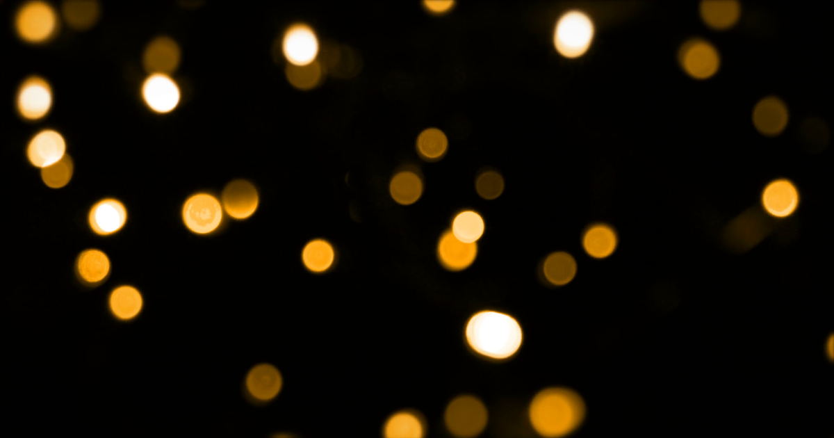 Defocused Bokeh Gold Christmas Light On Dark Background Vertical