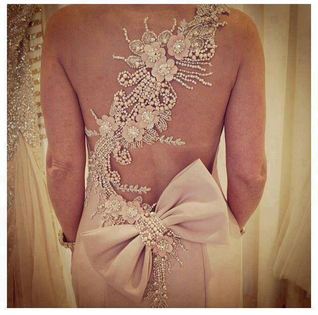 Gown with Detailed Diagonal Strap across back, Accented with a Large Bow at the base of Back