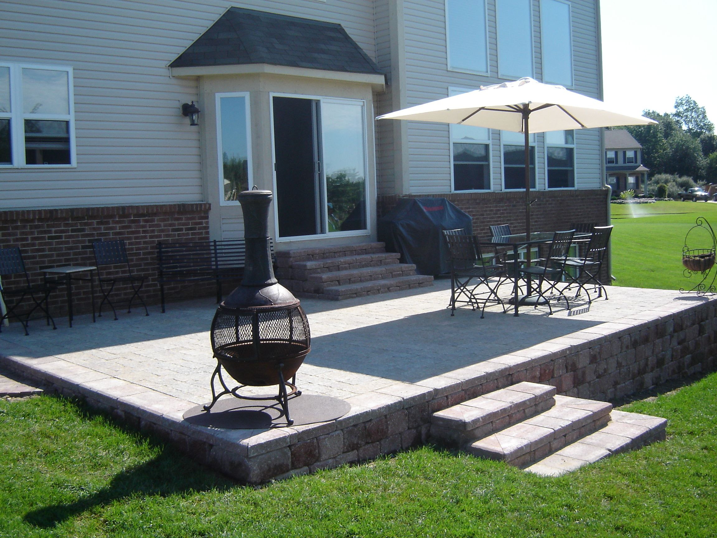 Great Raised Brick Paver Patio.