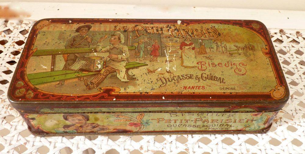 Boite ancienne en tole lithographiée  Le petit Parisien  , biscuit Nantais 1900