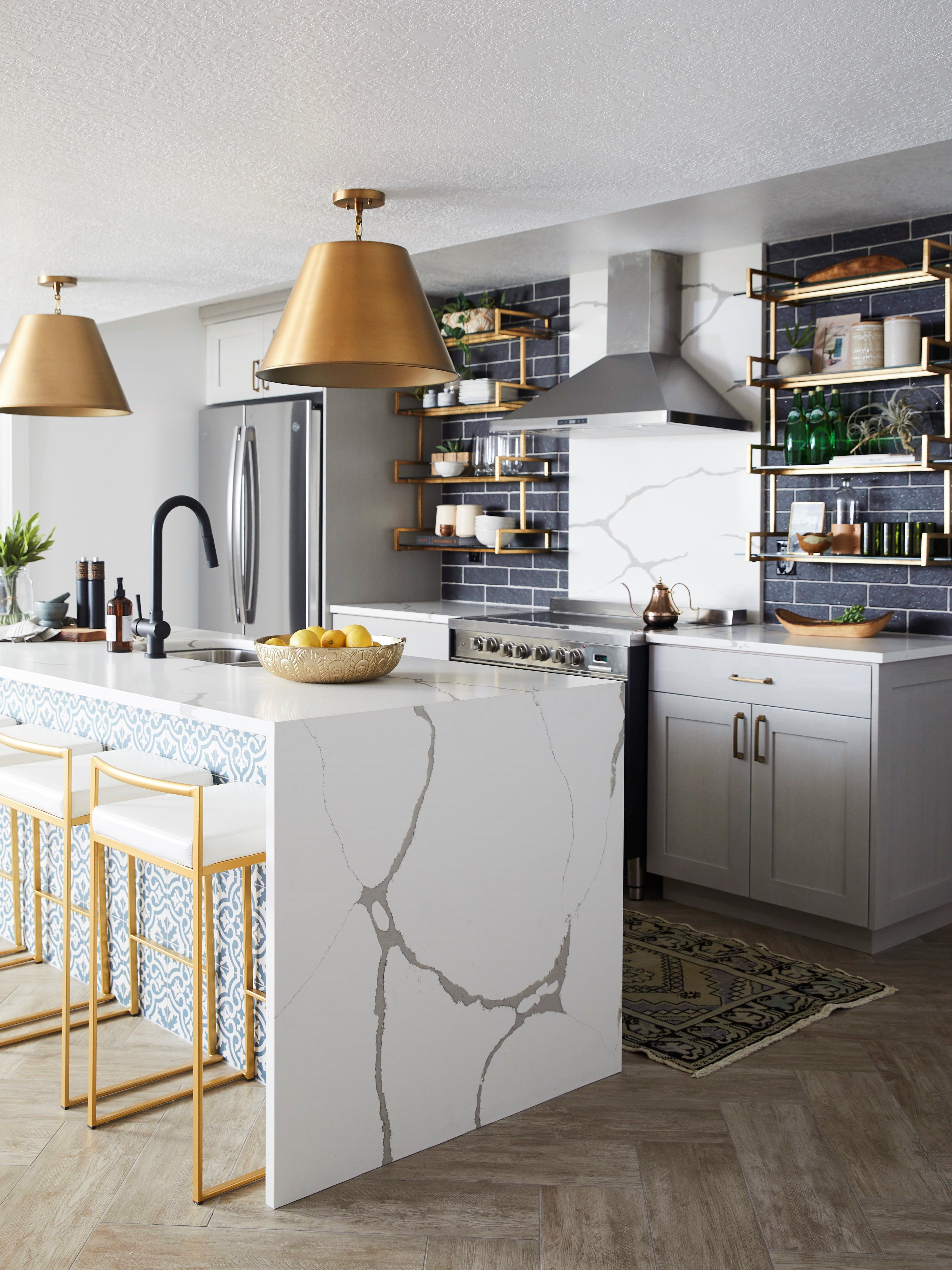loving the gold accents in this kitchen gold hardware marble countertop waterfall cou on kitchen remodel gold hardware id=61176