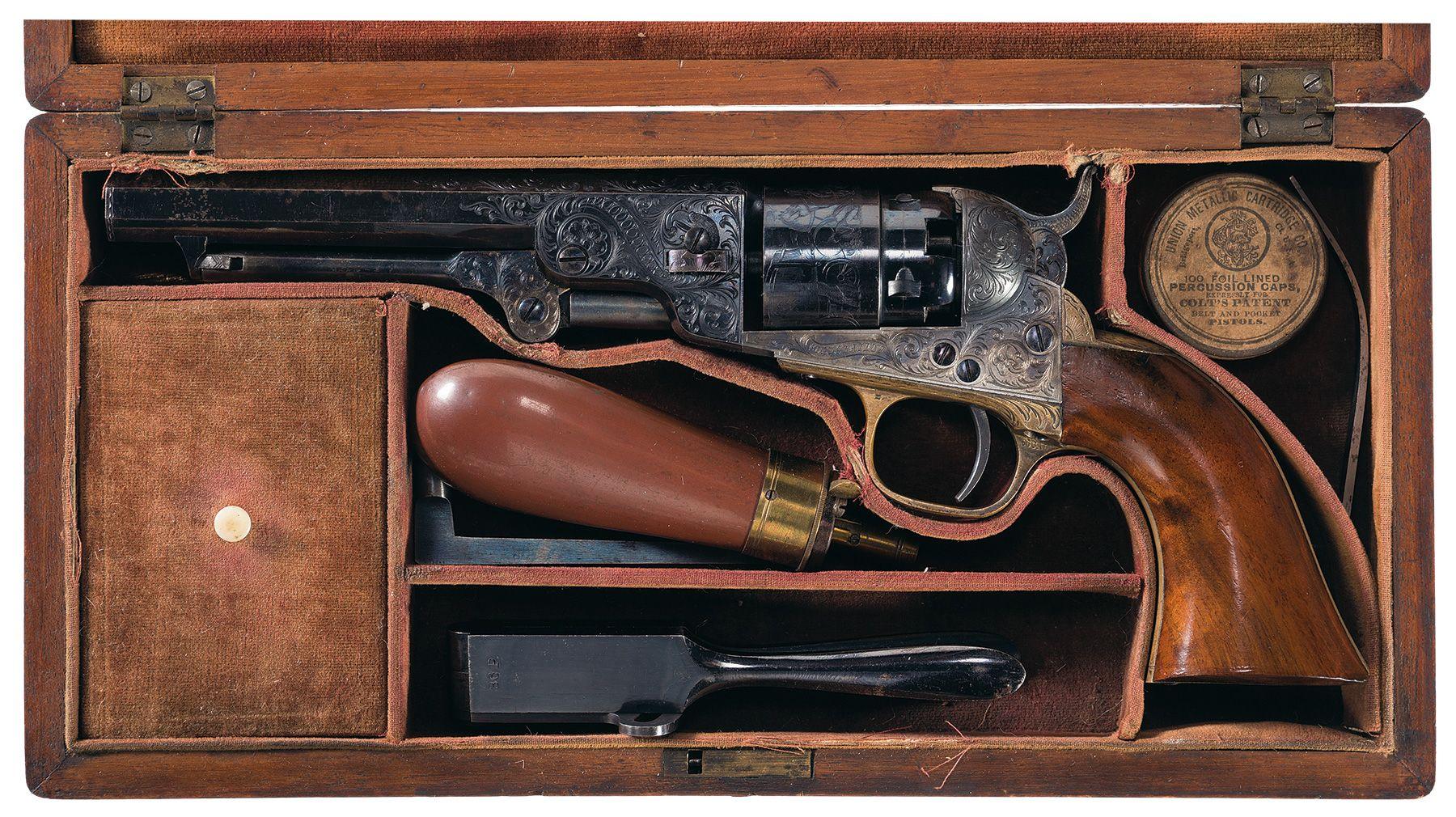 cased factory engraved colt model 1862 pocket navy revolver with