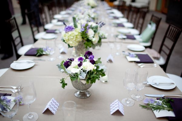 Reception Dinner Table Setting Tan Tablecloth Purple Napkins Folded With Purple Floral Food Table Decorations Wedding Floral Centerpieces Green Centerpieces