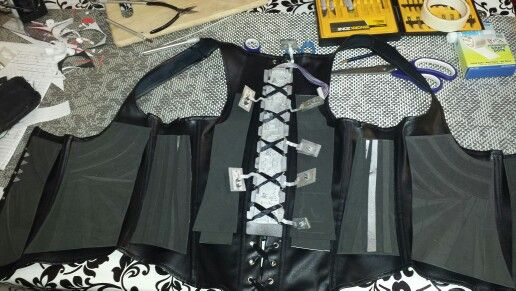 Adding panels and hardware to the corset