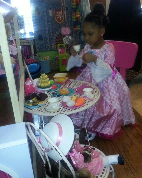 Someone is having fun with pretend Tea Party with Marie Grace and Cecile today.