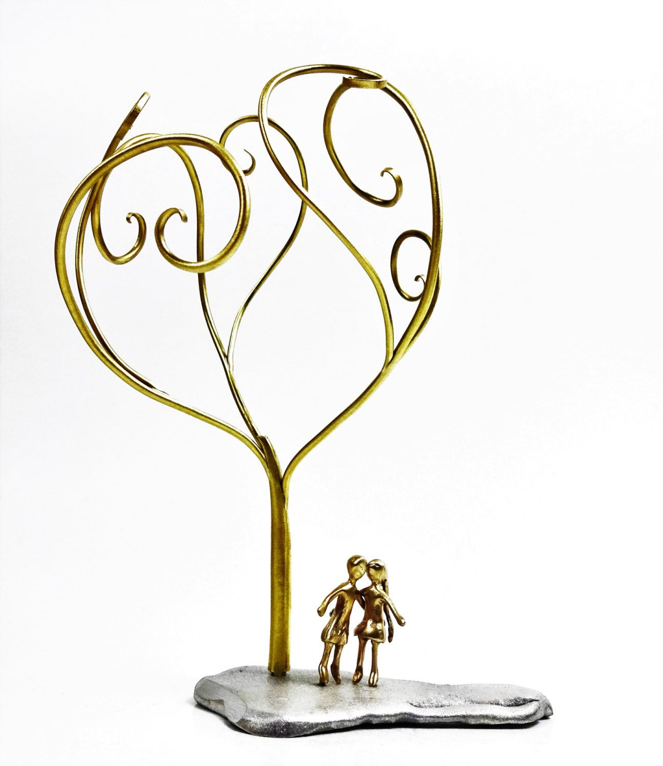 Bronze tree with a couple underneath. Home decoration