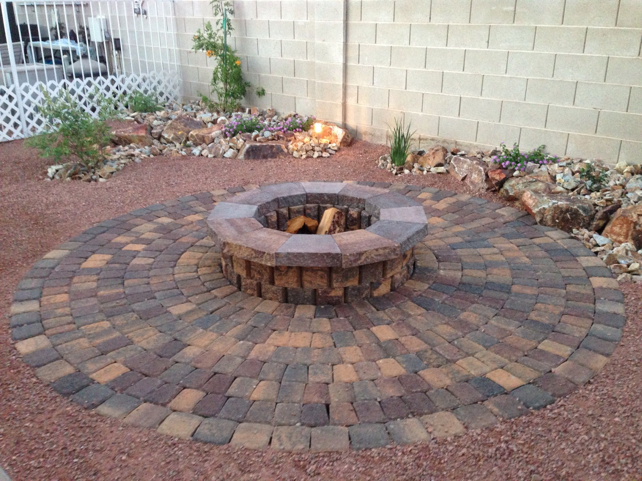what a great way to warm up your backyard parsons rocks on backyard fire pit landscaping id=47002