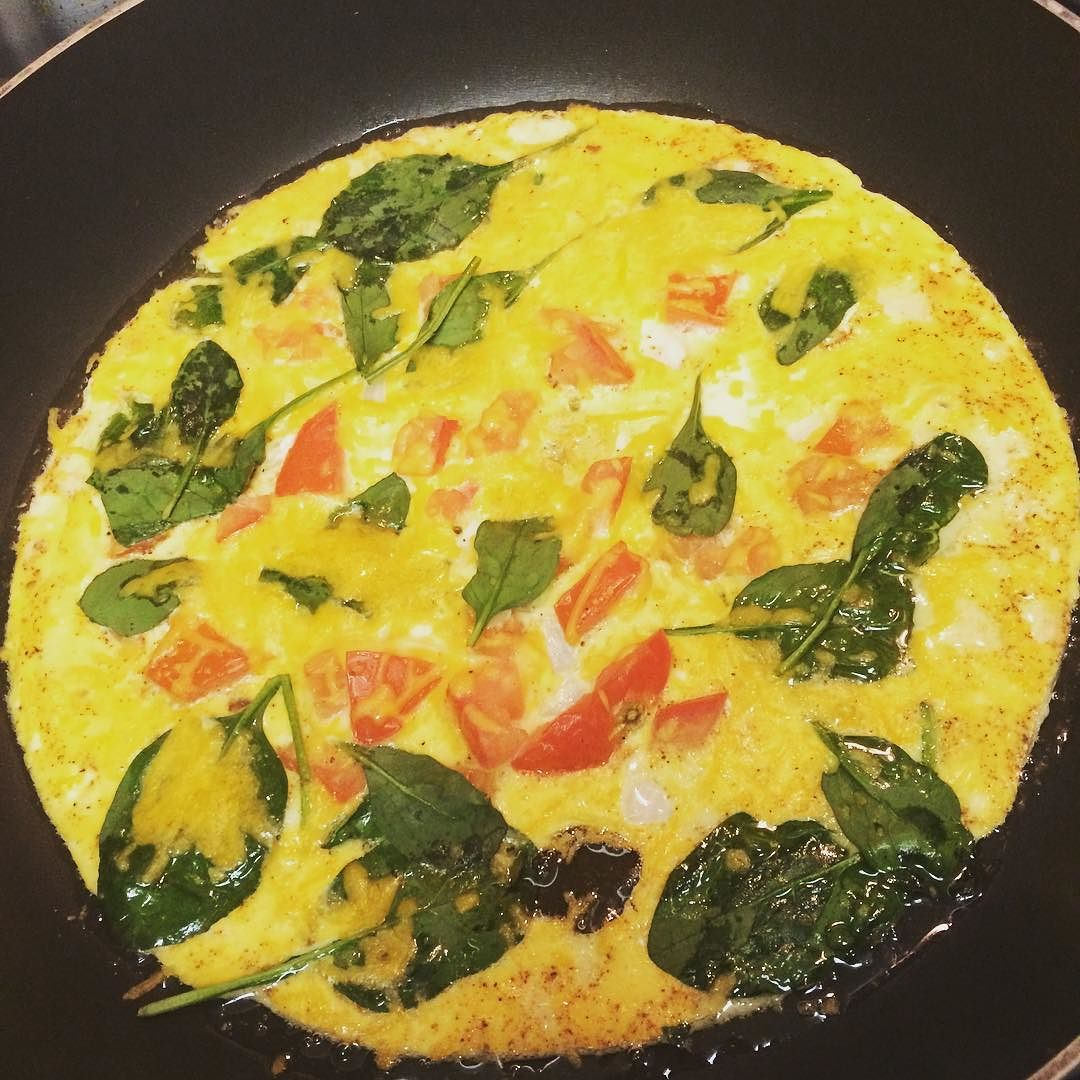 This morning's omelet with spinach tomatoes and cheese.  #lowcarb #fitspo #healthy #foodporn #foodstagram #omelet #highprotein #fitfuel by princess_sangria