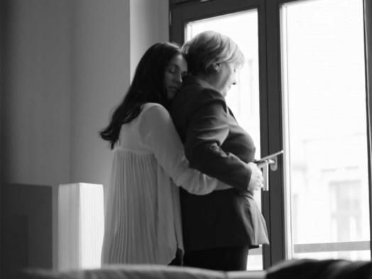 Hillary receiving a loving hug from her constant companion, Huma.