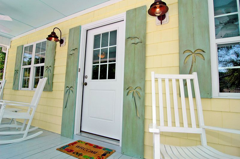 Decorative exterior shutters with palm tree cutouts. For more ...