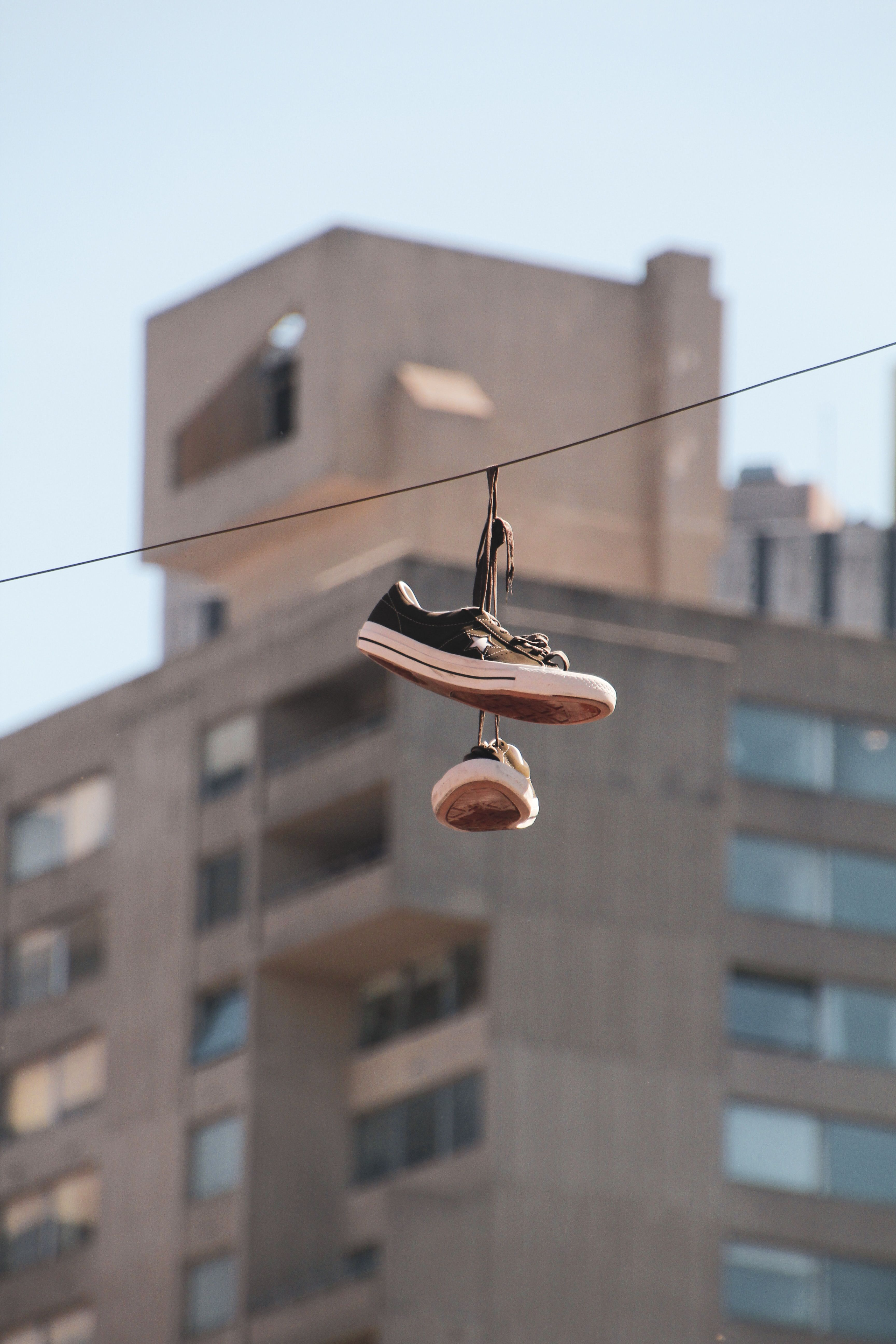 New York, NY, USA, shoes hanging from a wire over the