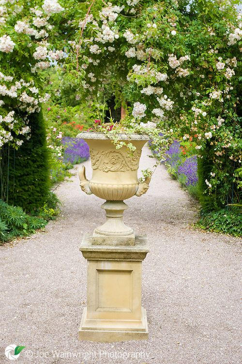 Urn on a plinth in the Walled Garden at Norton Priory, Cheshire.
