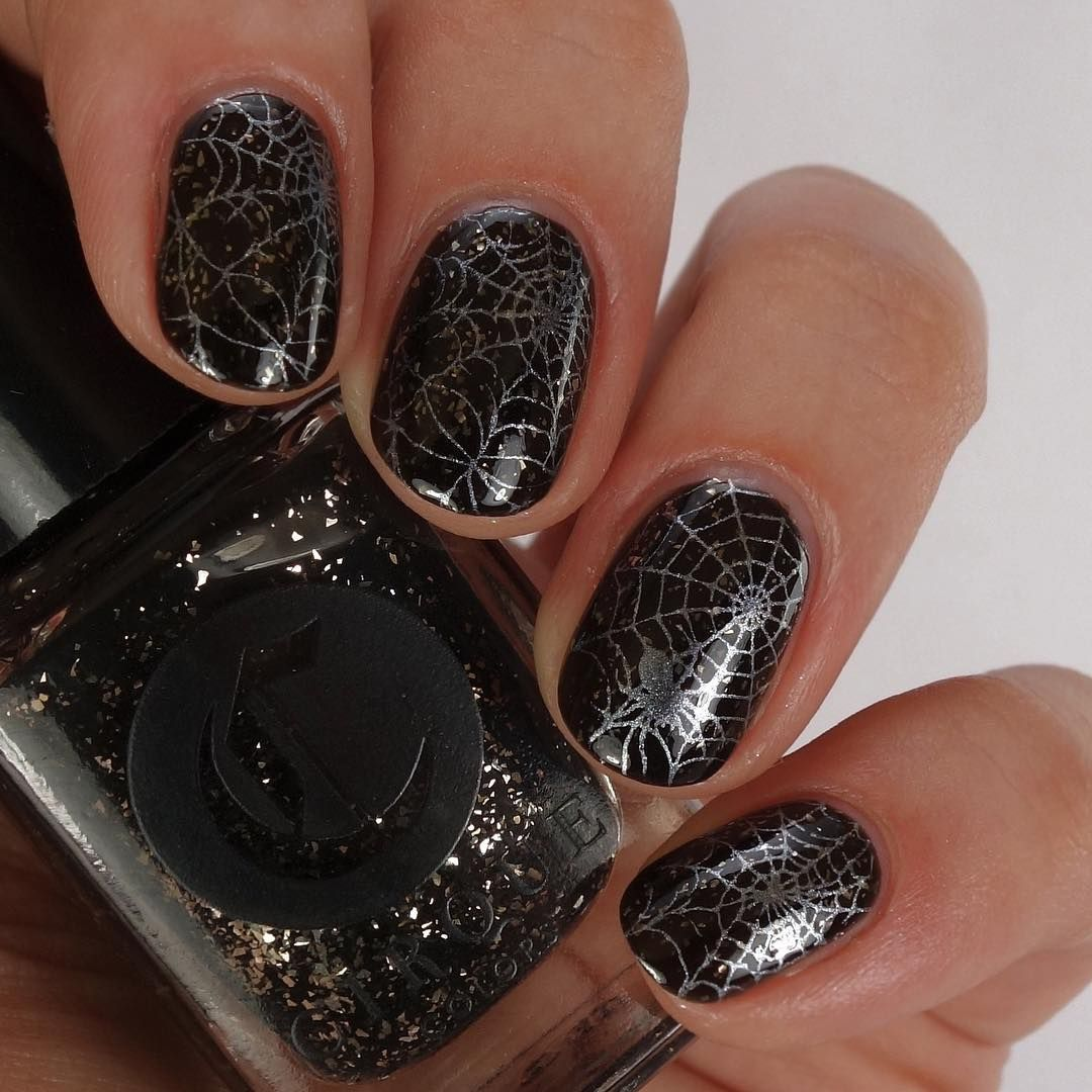 Spider web nails featuring Cirque Colors Gaia and Winstonia Store ...