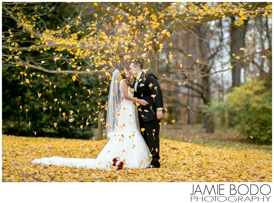 Yellow Leaves Falling On The Bride And Groom Autumn Nj Wedding At Frelinghuysen Arboretum