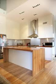 Loving the timber bench tops, white cabinets & silver splash ...