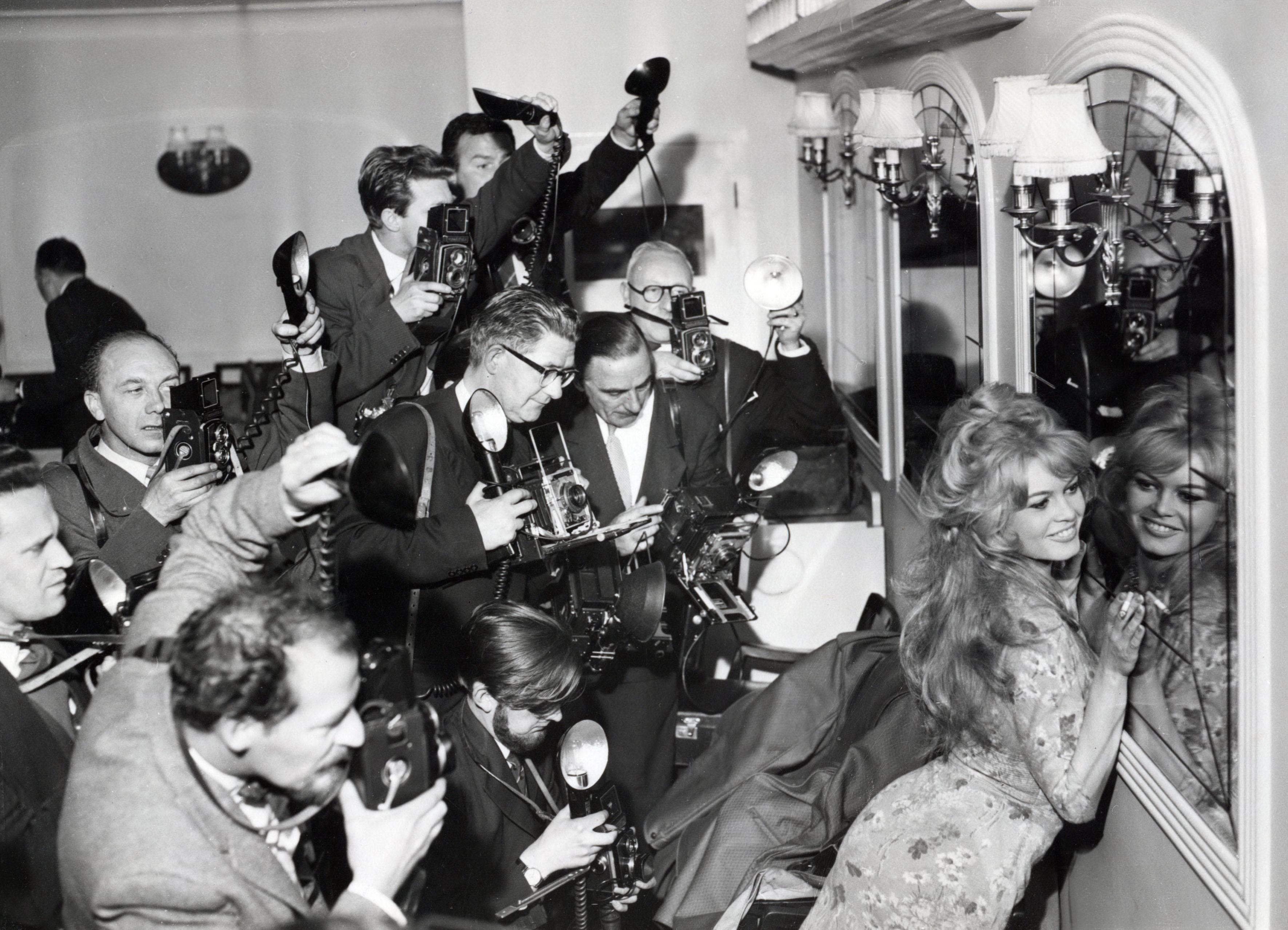 A Mo Bb Brigitte Bardot Surrounded By A Mob Of Photographers London