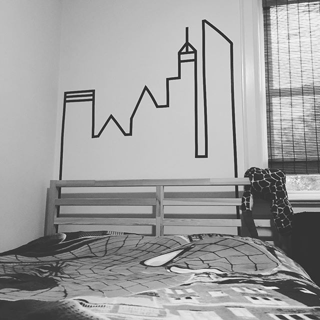 It is amazing to think that with less than one 99 cent roll of electrical tape and 10 minutes you can turn a 6 year old's blank bedroom wall into a city scape worthy of even the likes of your friendly neighbourhood Spiderman 🕷 #spiderman #washitape #electricaltape #bedroom #kids #decor #wallart #amazing #simple #hack