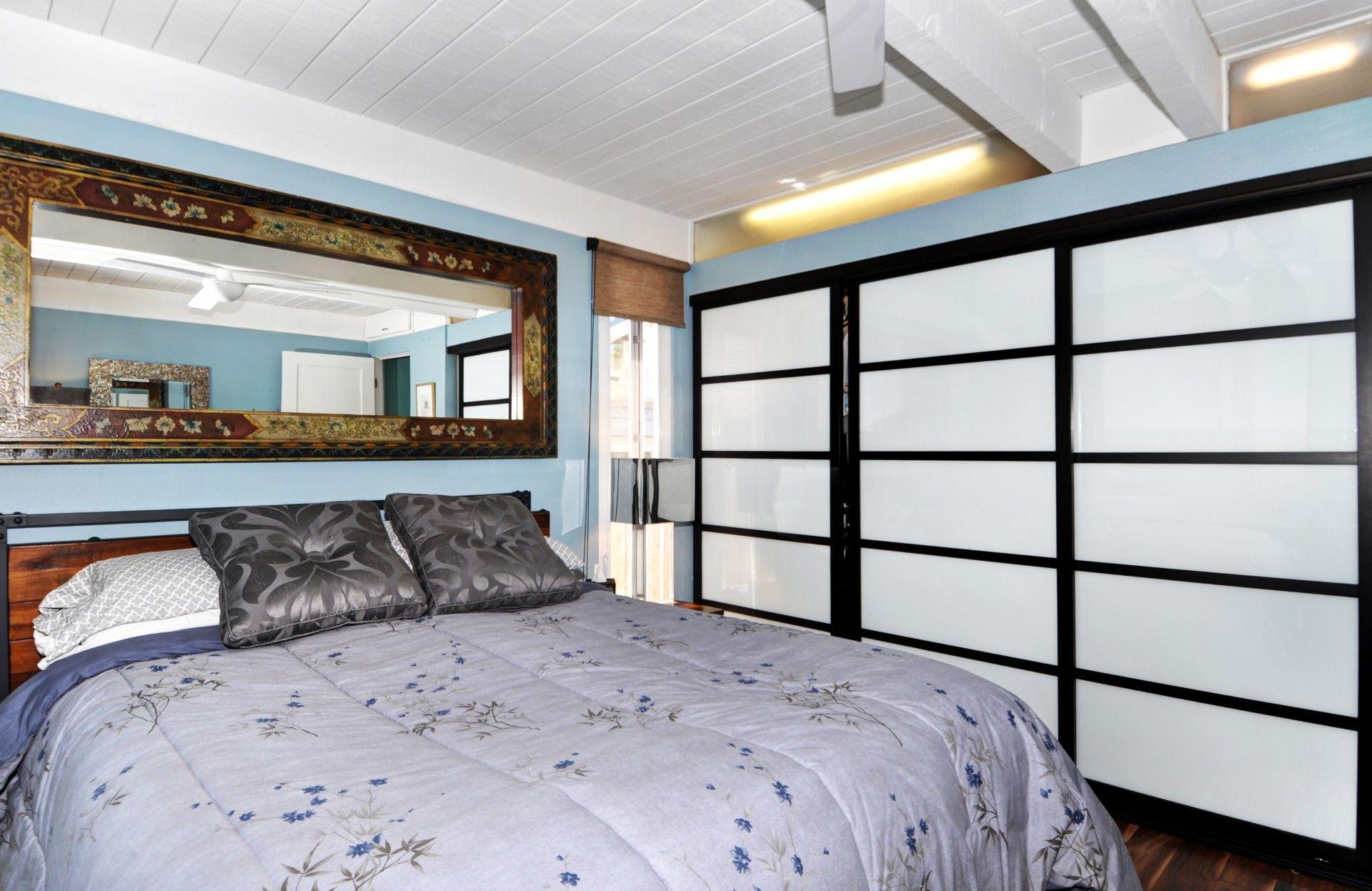 Shoji screen inspired sliding closet doors. zen bedroom
