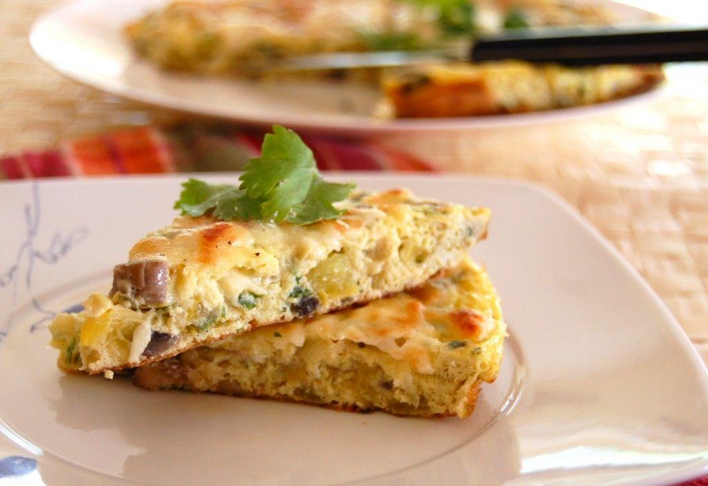 Frittata: mushroom, yellow zucchini, onion, cilantro, eggs, and mozzarella cheese.