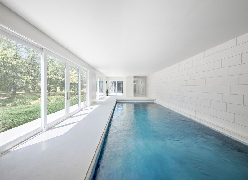 This Indoor Swimming Pool Area Opens To The Garden Outside Via
