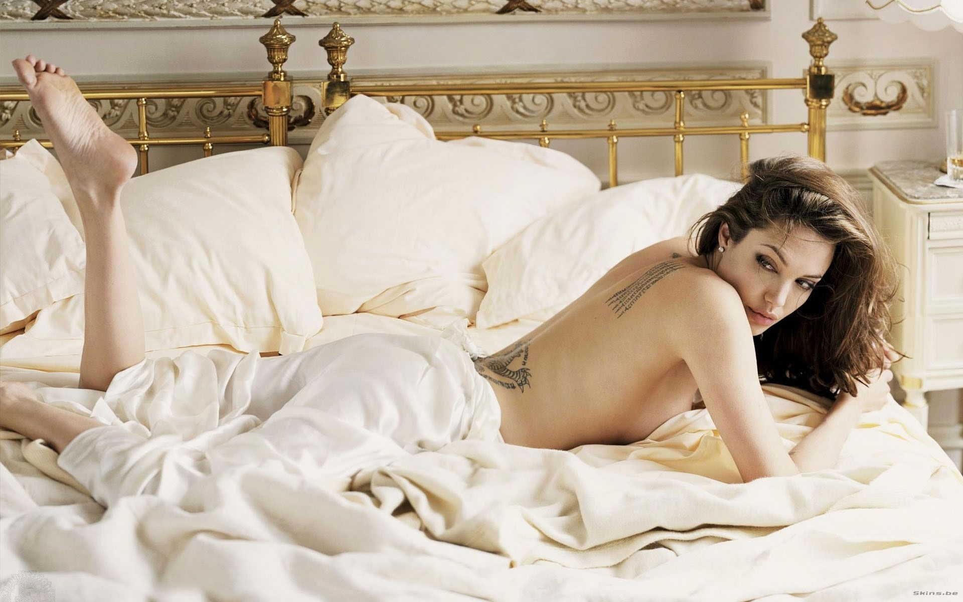 Sexy Angelina Jolie lying naked on bed showing back with tattoos she cover  her ass with sheet #hot #celebrities #celebrity #sexy #women #movies  #actresses