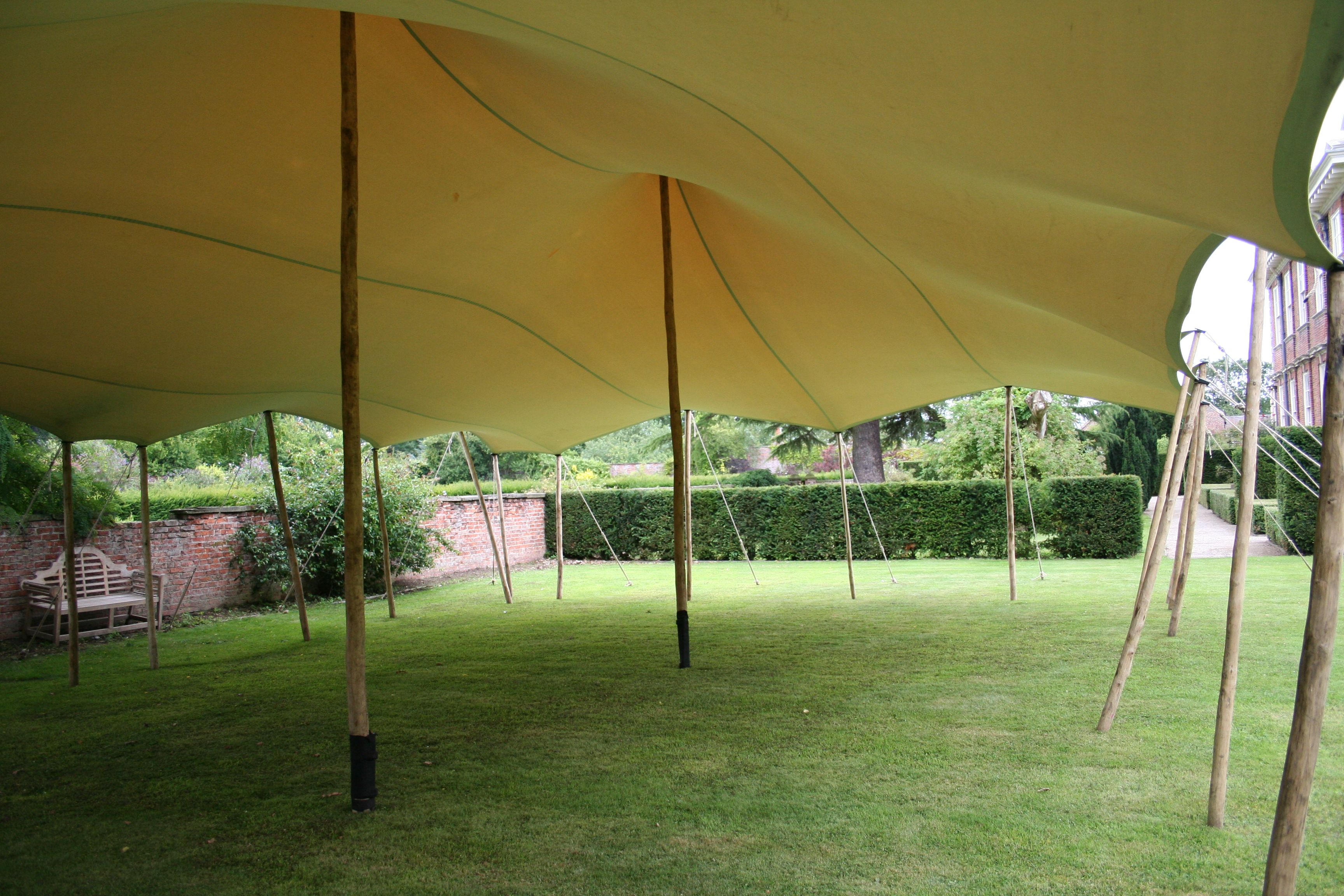 stretch tent curvy interior wooden poles 10x15m