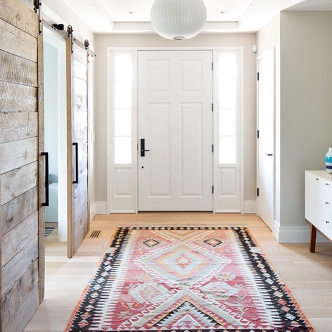 We are loving this entryway with the reclaimed barn doors that a ...