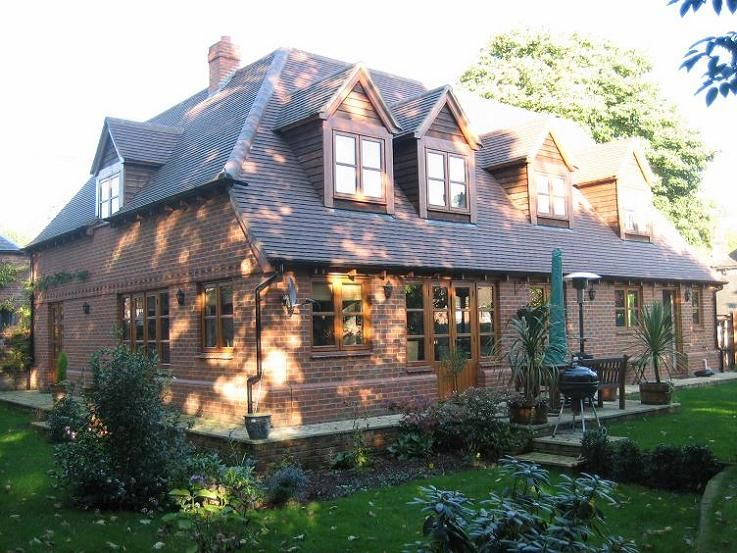 Timber frame house with brick skin and plain tile roof. Some feature ...
