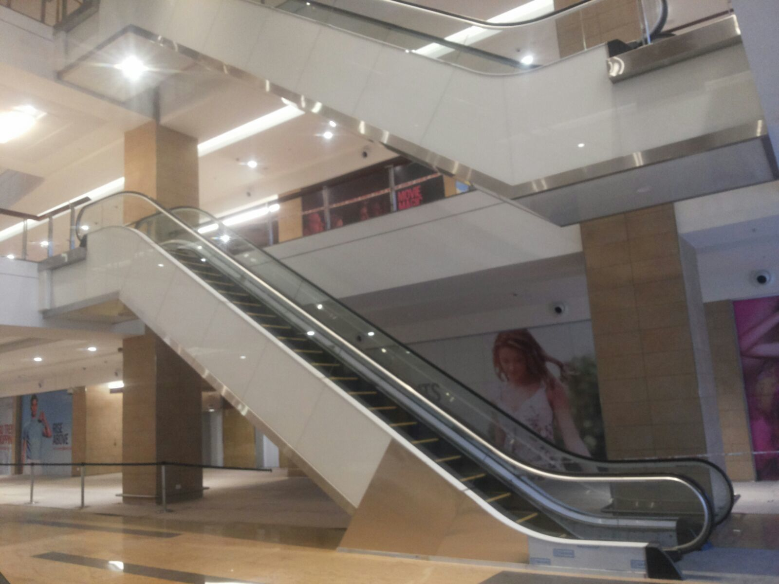 Escalator Cladding Sides And Soffit With Back Painted Gl