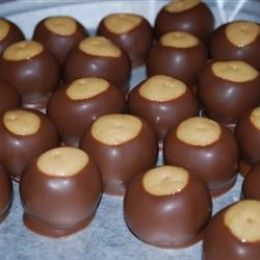 94b74528ce These Buckeye candies are not hard to make at all and can be used for  festive Christmas gifts! Buckeyes are peanut butter balls that are dipped  in chocolate ...