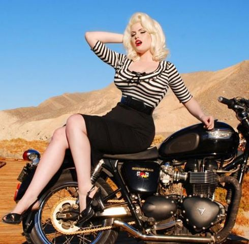 Doris Mayday - Motorcycle. Curvy and sexy in a black and white striped top and pencil skirt