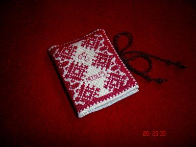 A cross stitch needle book  | Cross stitch boards, Cross