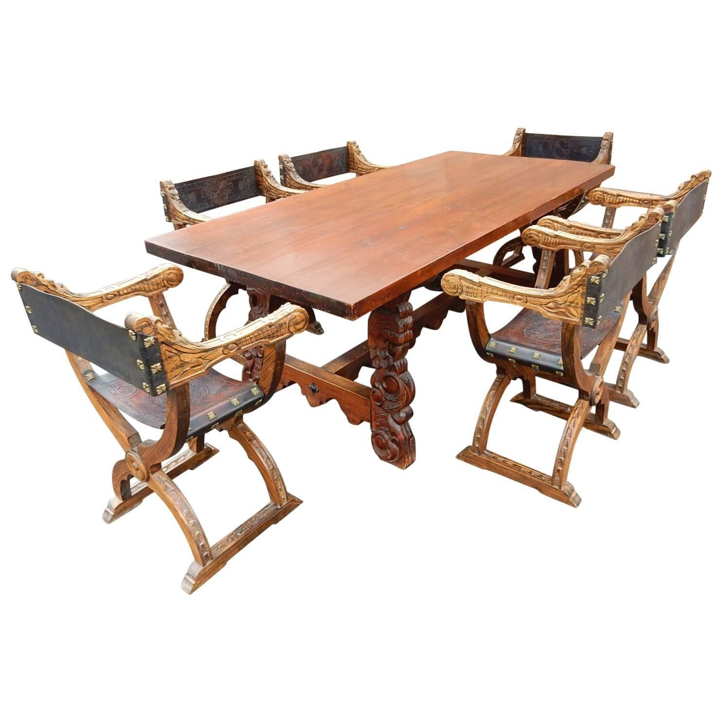 Spanish Colonial Dining Table With Six Elaborate Carved Wood And Leather Chairs Leather Chair Dining Table Dining