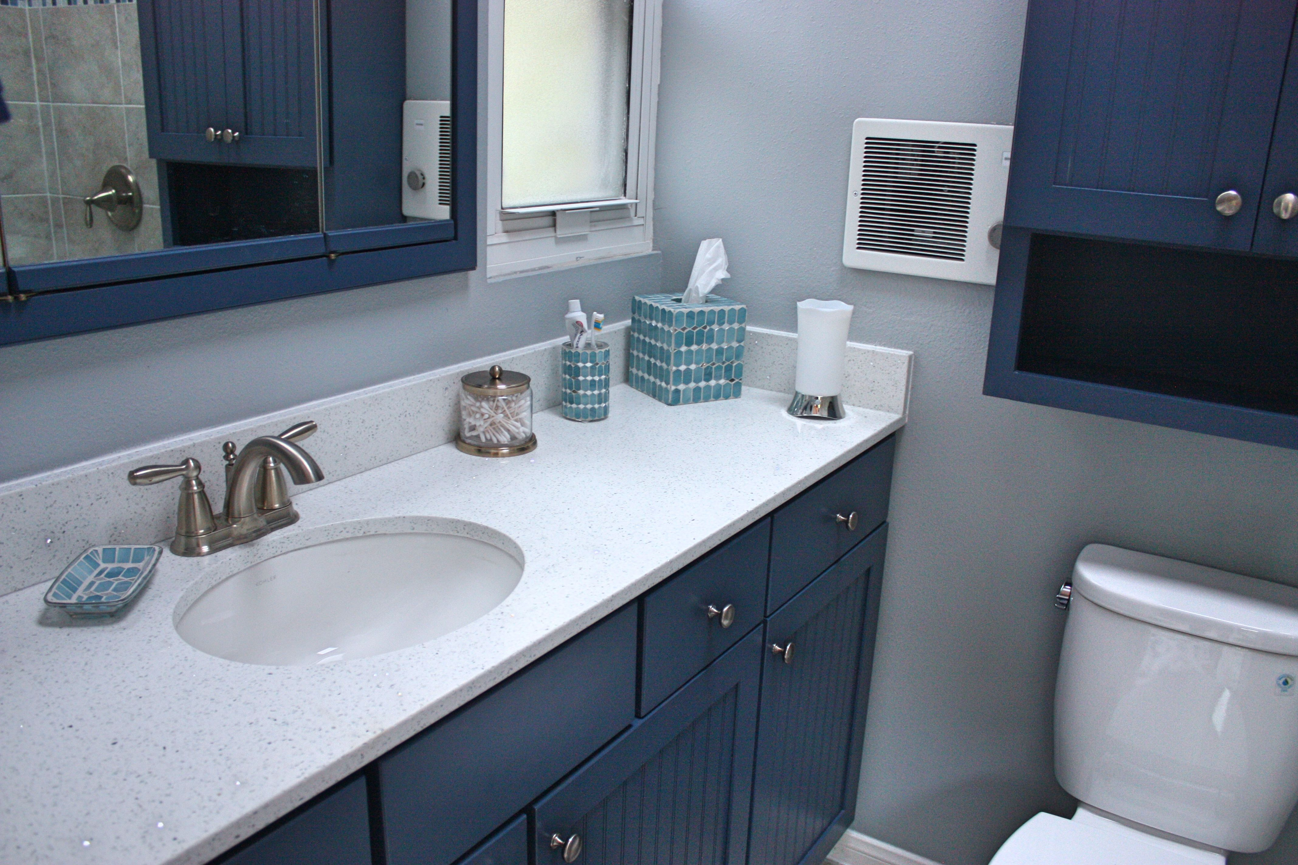 Blue cabinets with a white, sparkly quartz countertop. | Bathroom ...