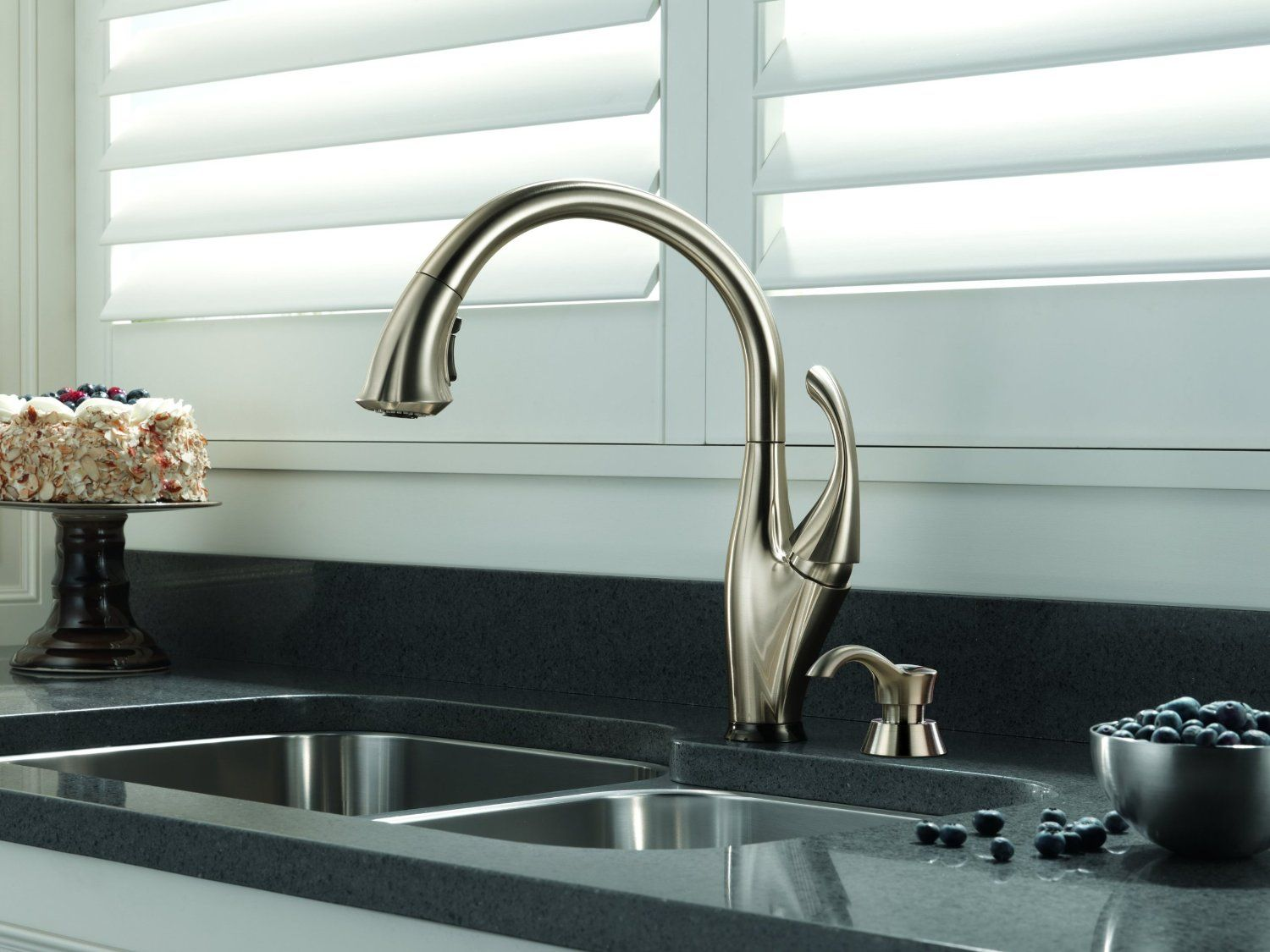 The faucet is finished in stainless steel with a contemporary style ...