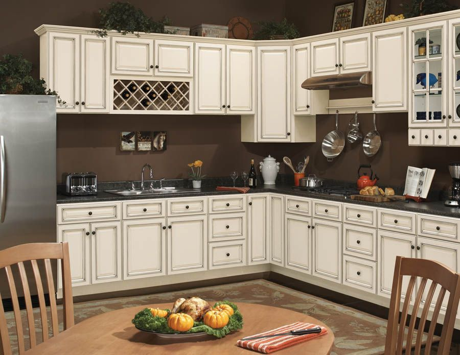 Wow! I like the cream cabinets with chocolate brown walls ...